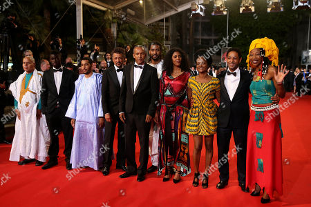 Hitchem Yacoubi, Abderrahmane Sissako, Abel Jafri, Ibrahim Ahmed dit Pino, Toulou Kiki Cast members, actor Hitchem Yacoubi, second right, actress Toulou Kiki, fourth right, director Abderrahmane Sissako, center, and actor Abel Jafri, fourth left, pose for photographers as they arrive for the screening of Timbuktu at the 67th international film festival, Cannes, southern France