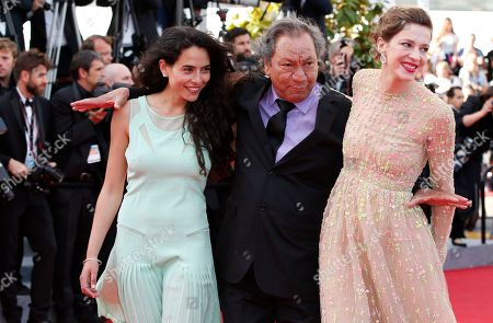 The cast of Geronimo, from left, actress Nailia Harzoune, director Tony Gatlif, and actress Celine Sallette pose for photographers as they arrive for the screening of Two Days, One Night (Deux jours, une nuit) at the 67th international film festival, Cannes, southern France