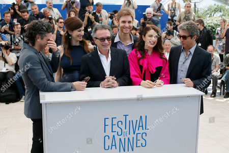 From left, actor Leonardo Sbaraglia, actress Maria Marull, actor Oscar Martinez, director Damian Szifron, actress Erica Rivas and actor Ricardo Darin pose for photographers during a photo call for Wild Tales (Relatos Salvajes) at the 67th international film festival, Cannes, southern France