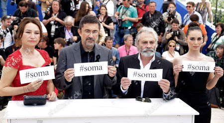"From left, actress Demet Akbag, director Nuri Bilgle Ceylan, actor Haluk Bilginer and actress Melisa Soezen pose for photographers with signs reading ""soma"", a reference to Turkey's worst mining incident in which hundreds of miners were killed earlier this week in Soma, Turkey, during a photo call for Winter Sleep at the 67th international film festival, Cannes, southern France, . At least 250 people died in a coal mine explosion and fire, which has set off a raft of protests and public outrage at allegedly poor safety conditions at Turkish coal mines, widespread corruption and what some perceived as government indifference"