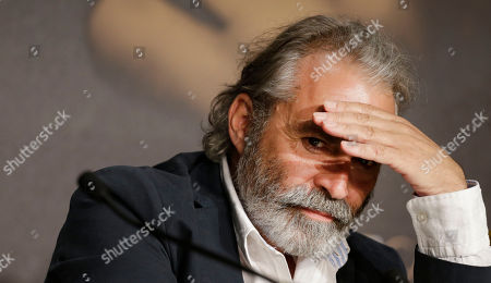 Haluk Bilginer Actor Haluk Bilginer shields his eyes during a press conference for Winter Sleep at the 67th international film festival, Cannes, southern France