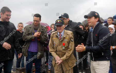 """George Calil, Shane Taylor, Ben Caplan, Ross McCall, James H. Martin Actors from the TV series """"Band of Brothers"""" left to right, George Calil, Shane Taylor, Ben Caplan, Ross McCall, applaud World War II veteran James H. Martin, 93, centre, from Newton, Iowa, who landed with the 101st Airborne, on Utah Beach, in Sainte-Marie du Mont, France, as part of D-Day commemorations. World leaders and veterans gathered by the beaches of Normandy on Friday to mark the 70th anniversary of World War Two's D-Day landings"""