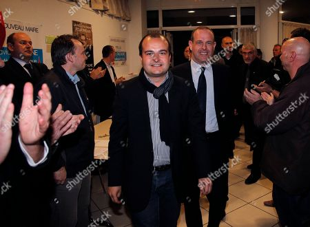 Steeve Briois, right, French far-right incoming mayor of the northern French city of Henin-Beaumont, who was elected last week, arrives to take part in a meeting with David Rachline, left, French far-right candidate for Frejus in the 2014 municipal elections, in Frejus, southeastern France . France's far-right National Front has conquered a symbolic northern town in Sunday's first round of municipal elections and led in some other cities, drawing calls by the governing left and rival right to stop the anti-immigration party's advance. The second round of municipal elections takes part on March 30 throughout France