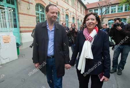 Anne Hidalgo, Jean-Marc Germain Socialist candidate for the mayor of Paris, Anne Hidalgo and her husband Jean-March Germain leave a polling station after voting for the municipal elections in Paris, . Voters in Paris and across France are going to the polls Sunday in municipal elections seen as a referendum on embattled President Francois Hollande's first two years in office. One bright spot for Hollande is the capital, where Hidalgo is favorite to defeat rival Nathalie Kosciusko-Morizet and keep Paris in Socialist control for another six-year term