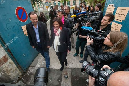 Anne Hidalgo, Jean-Marc Germain Socialist candidate for the mayor of Paris, Anne Hidalgo and her husband Jean-March Germain, left, leave a polling station after voting for the municipal elections in Paris, . Voters in Paris and across France are going to the polls Sunday in municipal elections seen as a referendum on embattled President Francois Hollande's first two years in office. One bright spot for Hollande is the capital, where Hidalgo is favorite to defeat rival Nathalie Kosciusko-Morizet and keep Paris in Socialist control for another six-year term