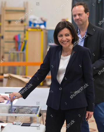 Anne Hidalgo, Jean-Marc Germain Socialist candidate for the mayor of Paris, Anne Hidalgo, casts her ballot during the municipal elections in Paris, . Voters in Paris and across France are going to the polls Sunday in municipal elections seen as a referendum on embattled President Francois Hollande's first two years in office. One bright spot for Hollande is the capital, where Hidalgo is favorite to defeat rival Nathalie Kosciusko-Morizet and keep Paris in Socialist control for another six-year term