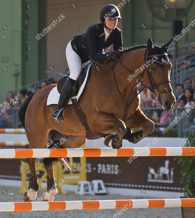 Reed Kessler Reed Kessler of the United States rides her horse Cos I Can, during the Grand Prix Hermes CSI5* horse show competition at the Grand Palais in Paris, . Reed Kessler finished fifth