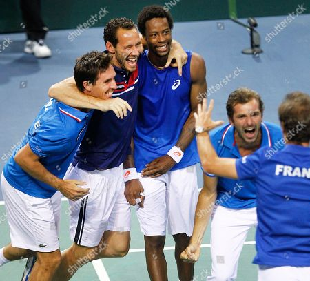 France's Gael Monfils, center, celebrates with teammates Michael llodra, second from left, and Julien Benneteau, right, after winning his singles match against German Peter Gojowczyk, in the quarterfinals of the Davis Cup in Nancy, eastern France, . France qualifies for the semifinals with a 3-2 score