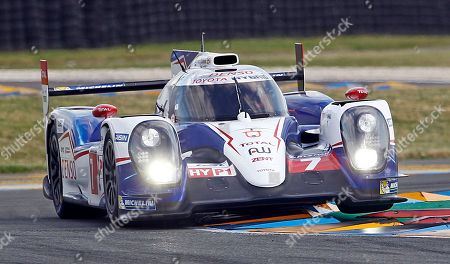 Stock Image of The Toyota TS 040 driven by Alexander Wurz of Austria, Stephane Sarrazin of France and Kazuki Nakajima of Japan in a curve of the Mans circuit, during a free practice session for the 24-hour Le Mans endurance race, in Le Mans, western France, . The race will take place on Saturday and Sunday
