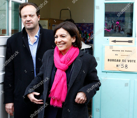 Anne Hidalgo, Jean-Marc Germain Socialist candidate for the mayor of Paris, Anne Hidalgo, leaves a polling station with her husband Jean-Marc Germain after voting for the municipal elections in Paris, . Voters across France are casting ballots in the first round of municipal elections Sunday as two female candidates compete to run Paris City Hall and far right candidates are hoping for a strong showing