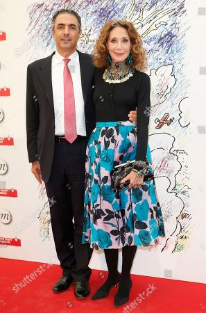 Stock Image of Marisa Berenson and Jean-Michel Simonian attend the Monumenta 2014 event at the Grand Palais in Paris in aid of the Naked Heart Foundation