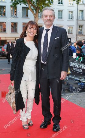 French football professional league (LFP) president Frederic Thiriez with his wife arrive at the 23th edition by the National Union of Professional Soccer (UNFP) awards in Paris