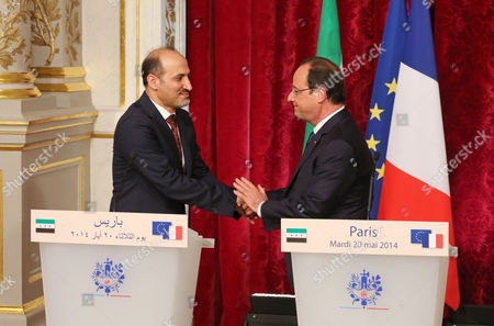 French President Francois Hollande, right, and the President of the Syrian National Coalition Ahmad Al-Assi A-Jarba, left, shake hand, at the end of their meeting at the Elysee Palace in Paris