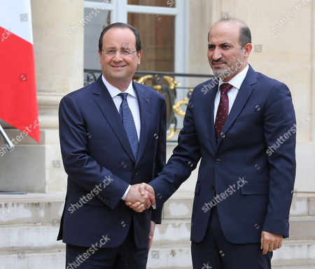 French President Francois Hollande greets the Syrian Opposition Coalition President Ahmad Jarba, right, prior to their meeting at the Elysee Palace in Paris