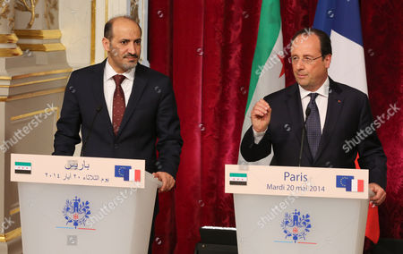 French President Francois Hollande, right, and the President of the Syrian National Coalition Ahmad Al-Assi A-Jarba, left, address reporters at the end of their meeting at the Elysee Palace in Paris