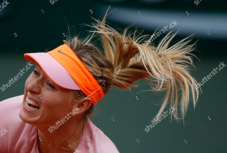 Russia's Maria Sharapova serves the ball to compatriot Ksenia Pervak during their first round match of the French Open tennis tournament at the Roland Garros stadium, in Paris, France, . Sharapova won 6-1, 6-2
