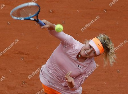 Russia's Maria Sharapova serves to compatriot Russia's Ksenia Pervak during the first round match of the French Open tennis tournament at the Roland Garros stadium, in Paris, France