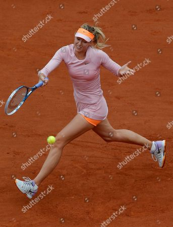 Russia's Maria Sharapova returns the ball to compatriot Ksenia Pervak during the first round match of the French Open tennis tournament at the Roland Garros stadium, in Paris, France
