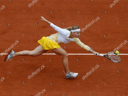 Russia's Ksenia Pervak returns the ball to compatriot Maria Sharapova during the first round match of the French Open tennis tournament at the Roland Garros stadium, in Paris, France
