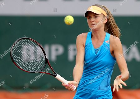 Slovakia's Daniela Hantuchova returns the ball to Serbia's Jovana Jaksic during the first round match of the French Open tennis tournament at the Roland Garros stadium, in Paris, France