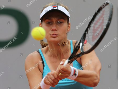 Stock Photo of Serbia's Jovana Jaksic returns the bal to Slovakia's Daniela Hantuchova during the first round match of the French Open tennis tournament at the Roland Garros stadium, in Paris, France