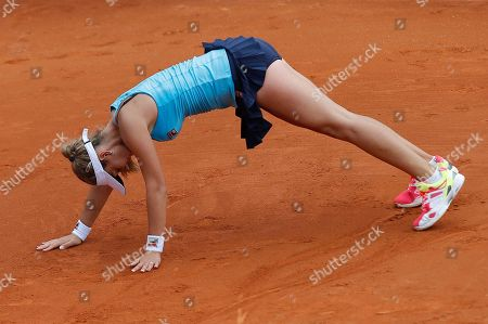 Serbia's Jovana Jaksic slips on the clay as she plays Slovakia's Daniela Hantuchova in the first round match of the French Open tennis tournament at the Roland Garros stadium, in Paris, France