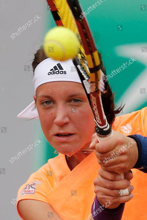 Germany's Dinah Pfizenmaier returns the ball during the second round match of the French Open tennis tournament against Italy's Sara Errani at the Roland Garros stadium, in Paris, France