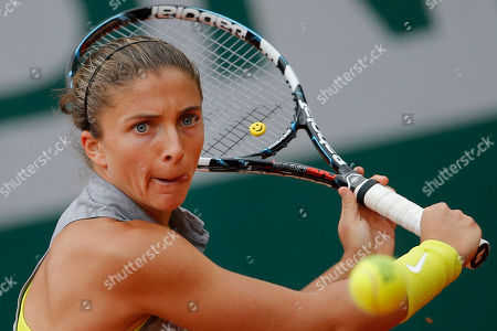 Italy's Sara Errani returns the ball during the second round match of the French Open tennis tournament against Germany's Dinah Pfizenmaier at the Roland Garros stadium, in Paris, France