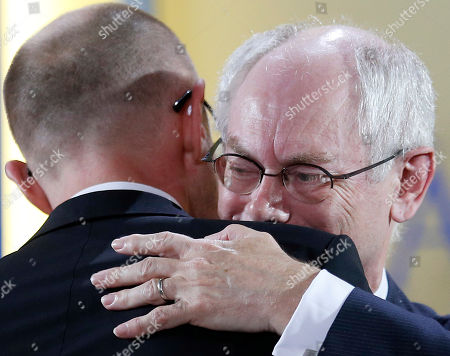 European Council President Herman Van Rompuy, right, hugs Ukrainian Prime Minister Arseniy Yatsenyuk after Rompuy received the International Charlemagne Prize of Aachen (Karlspreis) in Aachen, Germany, . The International prestigious Charlemagne Prize of Aachen is the oldest and best-known prize awarded for work done in the service of European unification. Former winners of the award include Jean-Claude Trichet (2011), U.S. President Bill Clinton (2000) and British Prime Minister Tony Blair (1999