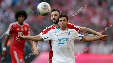 Hoffenheim's Kevin Volland, foreground, and Bayern's Diego Contento challenge for the ball during the German first division Bundesliga soccer match between FC Bayern Munich and TSG 1899 Hoffenheim, in Munich, southern Germany