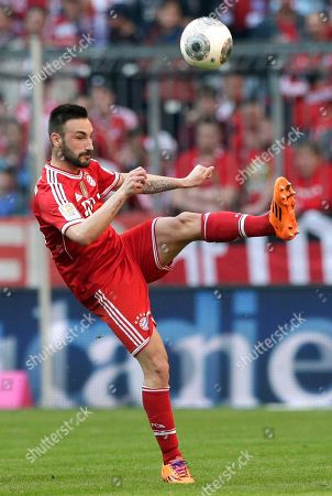 Bayern's Diego Contento kicks the ball during the German first division Bundesliga soccer match between FC Bayern Munich and TSG 1899 Hoffenheim, in Munich, southern Germany