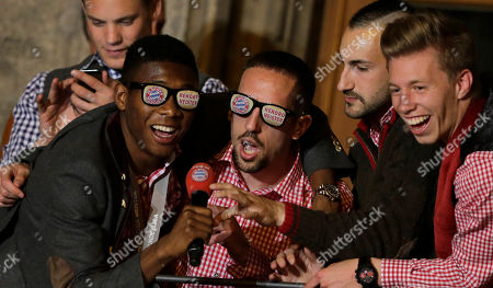 Bayern's David Alaba of Austria, from left, Franck Ribery of France, Diego Contento and Mitchell Weiser celebrate on the town hall balcony after winning the German Soccer Championship after the season's last home game between FC Bayern Munich and VfB Stuttgart, in Munich, southern Germany