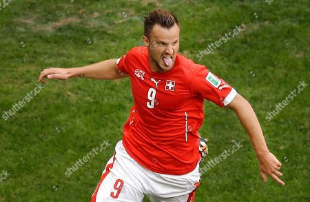Haris Seferovic FILE - In this June 15, 2014 file picture Switzerland's Haris Seferovic celebrates scoring his side's second goal during the group E World Cup soccer match between Switzerland and Ecuador at the Estadio Nacional in Brasilia, Brazil. German June 15, 2014 file picture Bundesliga soccer club Eintracht Frankfurt says it has signed Switzerland World Cup striker Haris Seferovic on a three-year contract from Real Sociedad. Seferovic follows Paraguary striker Nelson Valdez, signed for two years this week, and Brazilian midfielder Lucas Piazon, on a season-long loan from Chelsea