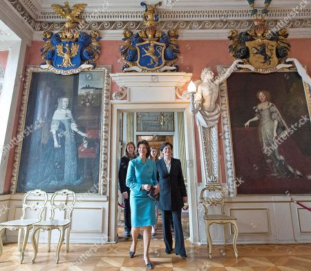 Queen Silvia of Sweden, left, arrives together with Christine Lieberknecht, governor of the German State of Thuringia, right, at the festival hall for the awarding ceremony of the 'Der Friedenstein' prize at the Friedenstein Castle in Gotha, Germany, . Queen Silvia will receive the award in recognition of her World Childhood Foundation, which helps abused and disadvantaged children
