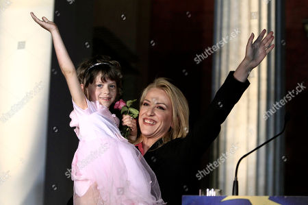 Rena Dourou The new regional governor of Attica Rena Dourou waves with a young girl to her supporters in Athens early . The left-wing opposition Syriza party has succeeded in capturing first place in Greece's election for the European Parliament, leading conservative New Democracy by about 3.5 percent. The radical left party, which has been fiercely critical of the austerity policies pursued since 2010 by the heavily indebted country and imposed by its creditors, claimed an important victory in Greece's local and regional elections that took place simultaneously by winning the Attica region, where almost 30 percent of all Greek voters are registered