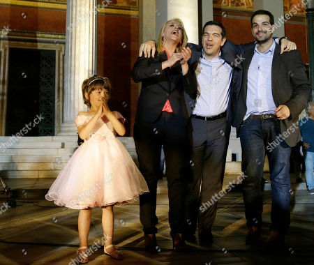 Main opposition leader Alexis Tsipras, center, the new regional governor of Attica Rena Dourou, left, and loosing challenger for Athens' Mayor Gavriil Sakellaridis sing with their supporters in Athens early . The left-wing opposition Syriza party has succeeded in capturing first place in Greece's election for the European Parliament, leading conservative New Democracy by about 3.5 percent. The radical left party, which has been fiercely critical of the austerity policies pursued since 2010 by the heavily indebted country and imposed by its creditors, claimed an important victory in Greece's local and regional elections that took place simultaneously by winning the Attica region, where almost 30 percent of all Greek voters are registered