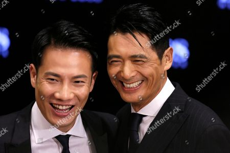 Chow Yun-fat, Real Ting Hong Kong actor Chow Yun-fat, right, and Real Ting, husband of Hong Kong singer Miriam Yeung pose for photographers during the opening ceremony of Hugo Boss store in Hong Kong