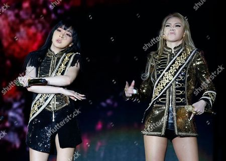 Lee Chae-rin, Park Bom Members of South Korean K-Pop girl group 2NE1 Lee Chae-rin, right and Park Bom perform during their concert as part of the world tour in Hong Kong