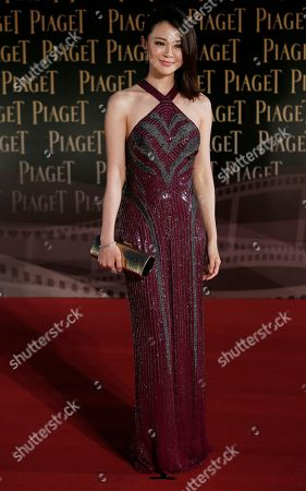 Guan Yue Guan Yue, wife of Chinese actor Tong Dawei poses on the red carpet of the 33rd Hong Kong Film Awards in Hong Kong