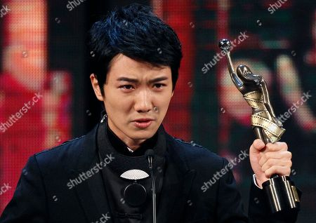 """Babyjohn Choi Hong Kong actor Babyjohn Choi raises the trophy after winning the Best New Performer for his role in the movie """" The Way We Dance """" at the 33rd Hong Kong Film Awards in Hong Kong"""