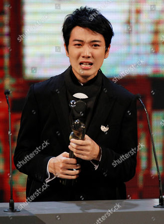 """Stock Image of Babyjohn Choi Hong Kong actor Babyjohn Choi reacts after winning the Best New Performer for his role in the movie """" The Way We Dance """" at the 33nd Hong Kong Film Awards in Hong Kong"""
