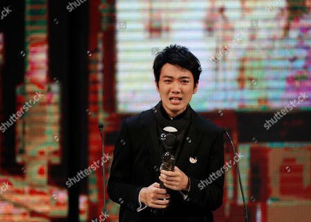 """Stock Picture of Babyjohn Choi Hong Kong actor Babyjohn Choi reacts after winning the Best New Performer for his role in the movie """"The Way We Dance"""" at the 33rd Hong Kong Film Awards in Hong Kong"""