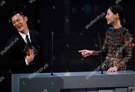 Isabella Leong, Shawn Yue Hong Kong actor Shawn Yue, left, and Chinese actress Isabella Leong joke on stage during the presentation ceremony at the 33rd Hong Kong Film Awards in Hong Kong
