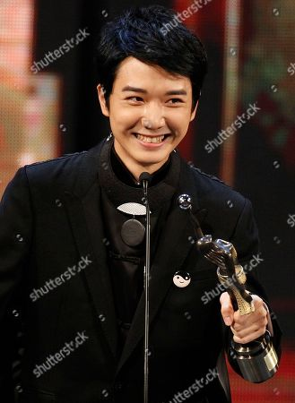 """Babyjohn Choi Hong Kong actor Babyjohn Choi reacts after winning the Best New Performer for his role in the movie """" The Way We Dance"""" at the 33rd Hong Kong Film Awards in Hong Kong"""