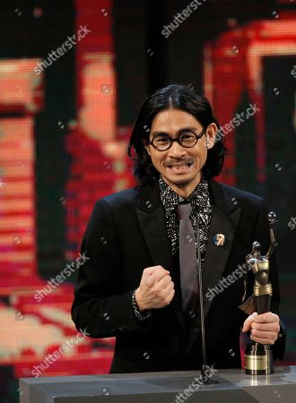 """Stock Photo of Adam Wong Hong Kong director Adam Wong reacts after winning the Best New Director for the movie """"The Way We Dance"""" at the 33rd Hong Kong Film Awards in Hong Kong"""
