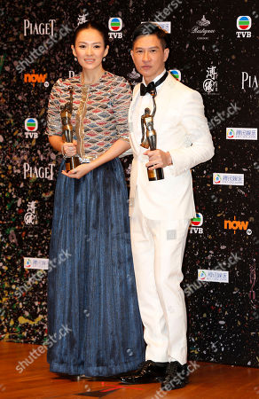 """Zhang Ziyi, Nick Cheung Ka-fai Chinese actress Zhang Ziyi, left, and actor Nick Cheung Ka-fai pose after winning the Best Actress award for her movie """"The Grandmaster"""" and Best Actor awards for his movie """"Unbeatable"""" of the 33rd Hong Kong Film Awards in Hong Kong"""