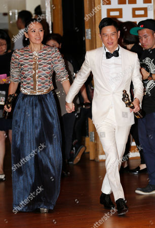 """Zhang Ziyi, Nick Cheung Ka-fai Chinese actress Zhang Ziyi, left, and actor Nick Cheung Ka-fai pose after winning the Best Actress award of her movie """"The Grandmaster"""" and Best Actor awards of his movie """"Unbeatable"""" of the 33rd Hong Kong Film Awards in Hong Kong"""