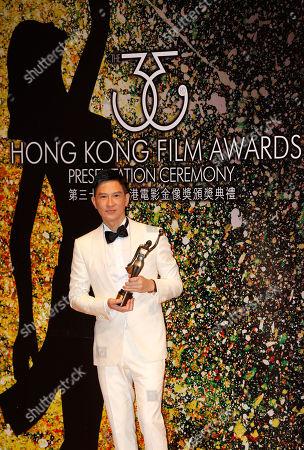"""Nick Cheung Ka-fai Hong Kong actor Nick Cheung Ka-fai poses after winning the Best Actor award for his movie """"Unbeatable"""" of the 33rd Hong Kong Film Awards in Hong Kong"""