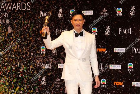"""Nick Cheung Ka-fai Hong Kong actor Nick Cheung Ka-fai poses after winning the Best Actor award of his movie """"Unbeatable"""" of the 33rd Hong Kong Film Awards in Hong Kong"""