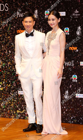 """Nick Cheung Ka-fai, Angelababy Hong Kong actor Nick Cheung Ka-fai, left and Hong Kong actress Angelababy pose after winning the Best Actor award of his movie """"Unbeatable"""" of the 33rd Hong Kong Film Awards in Hong Kong"""